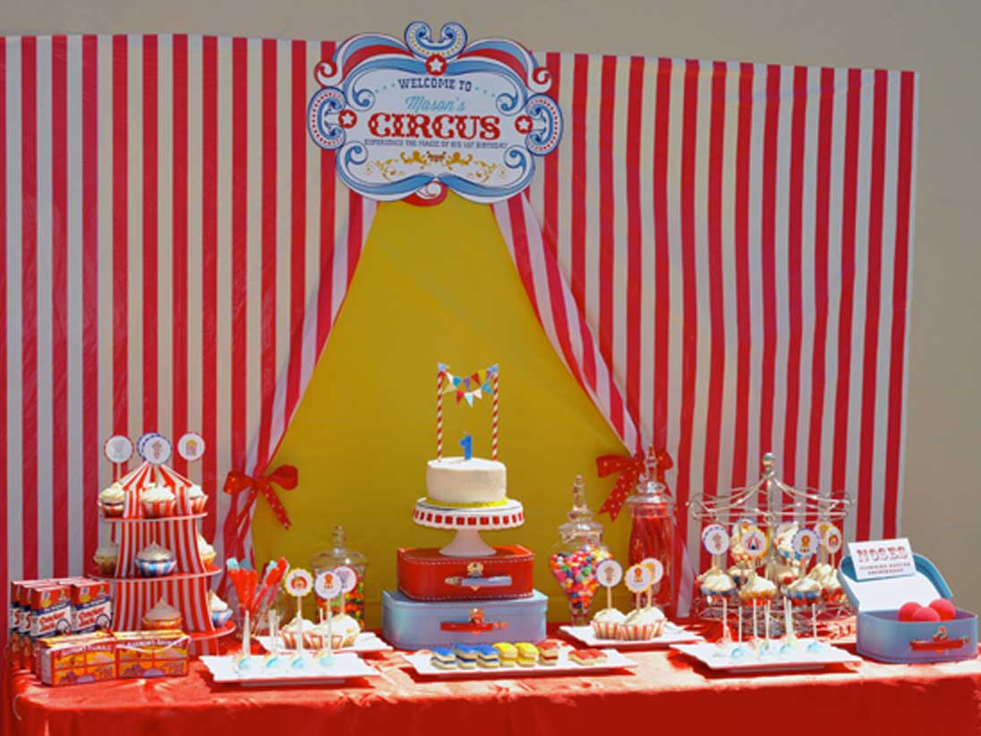 Cherry On Top Parties delivers an amazing Circus Carnival theme party for a 1st birthday.  Decorations, activities, games, favors, and more!